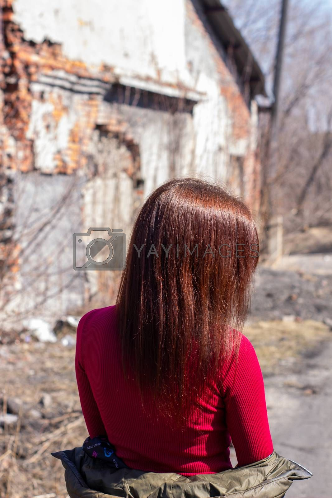 Women's hair brown color on the street, on a Sunny day. Beautiful women's hair with brown ash color.