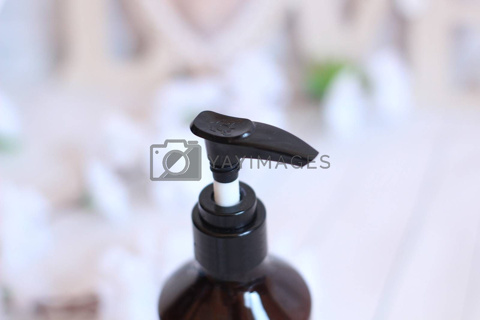 Transparent brown Bottles for Shampoo, Soap or other cosmetic on white background.