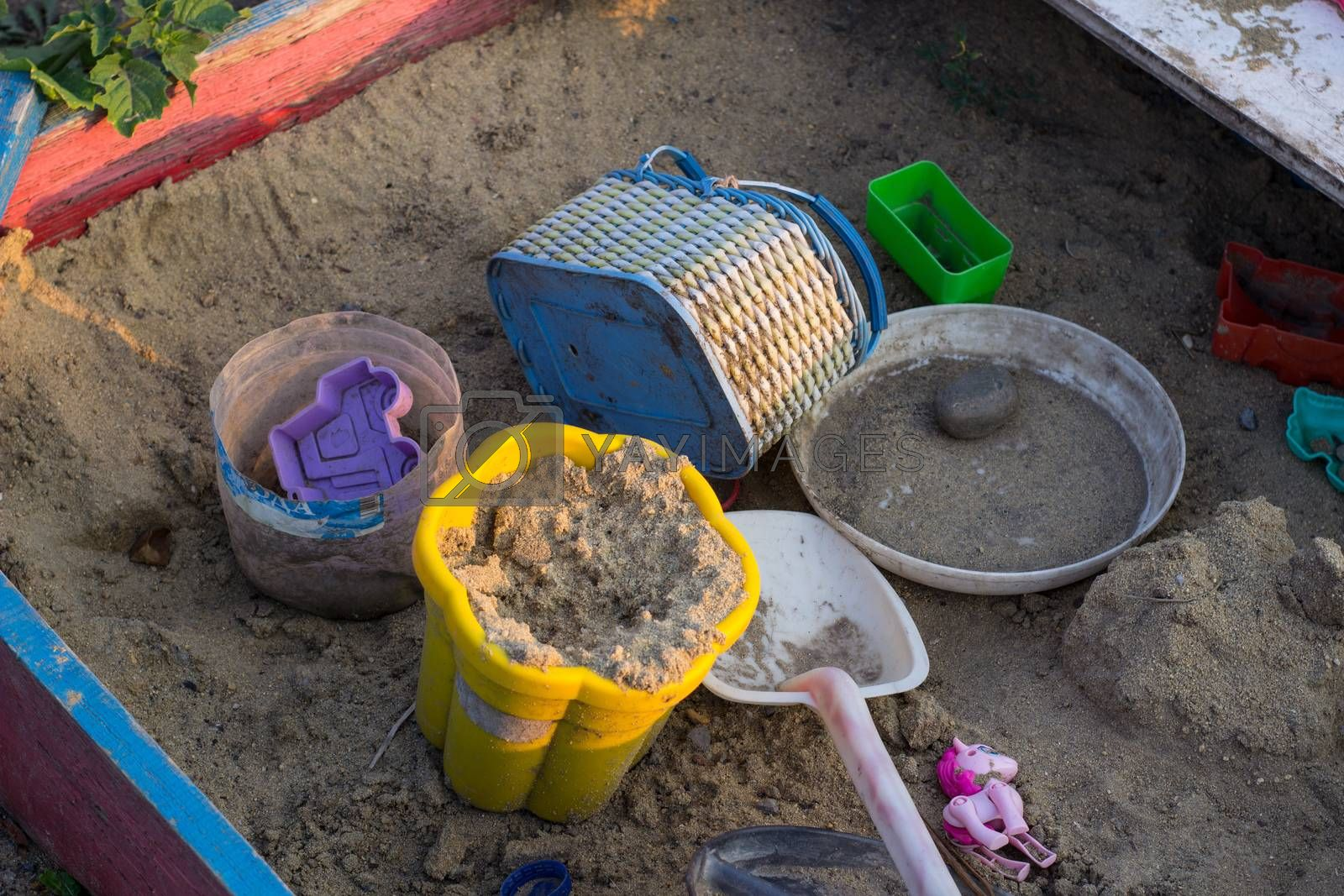Sandcastle with bucket and shovel
