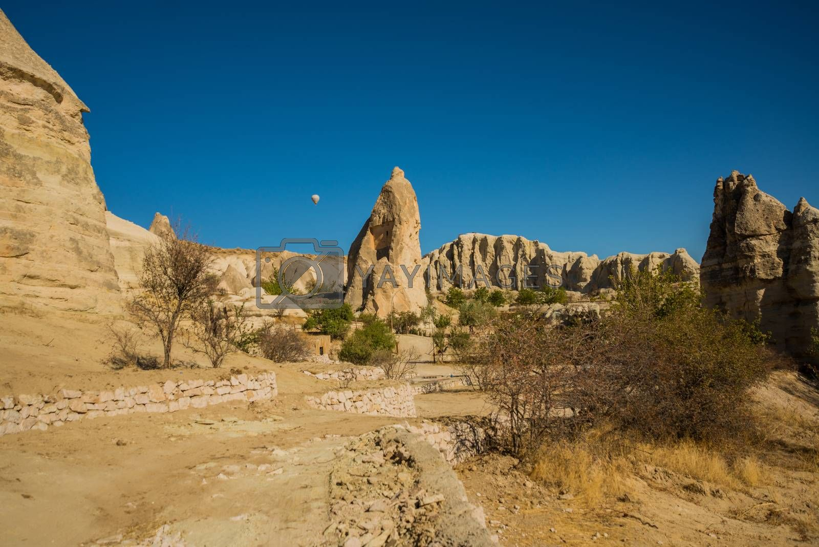 Cappadocia, Turkey: Flying in a balloon. Mountain view in summer in Sunny weather. The great tourist attraction of Cappadocia - balloon flight.