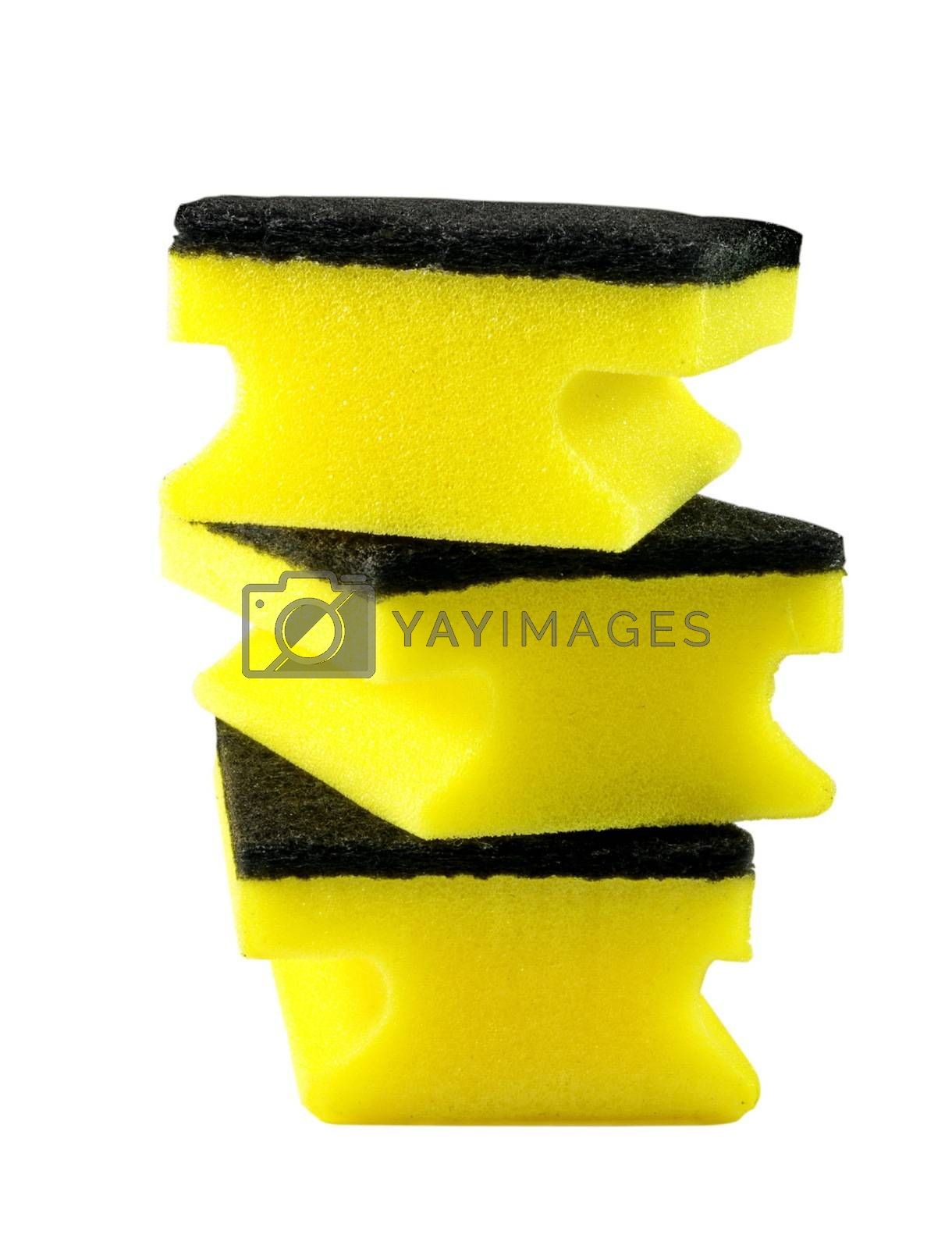 three yellow cleaning sponges over white