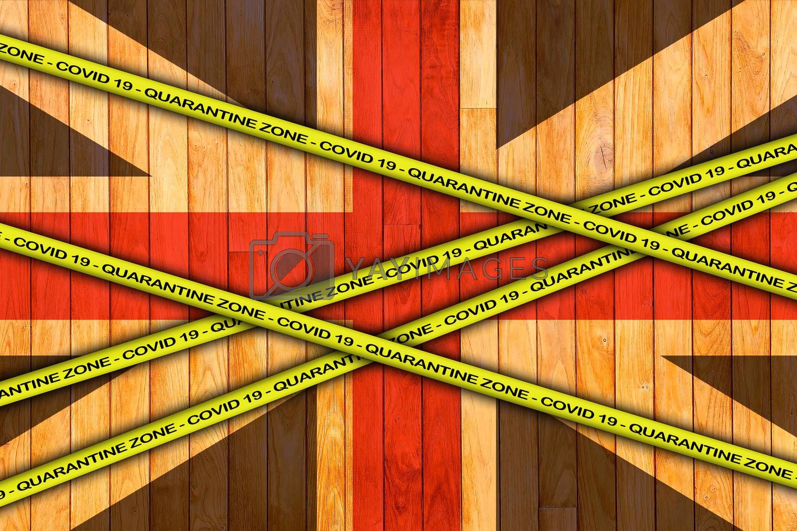 COVID-19 warning yellow ribbon written with: Quarantine zone Cover 19 on United Kingdom flag illustration. Coronavirus danger area, quarantined country.