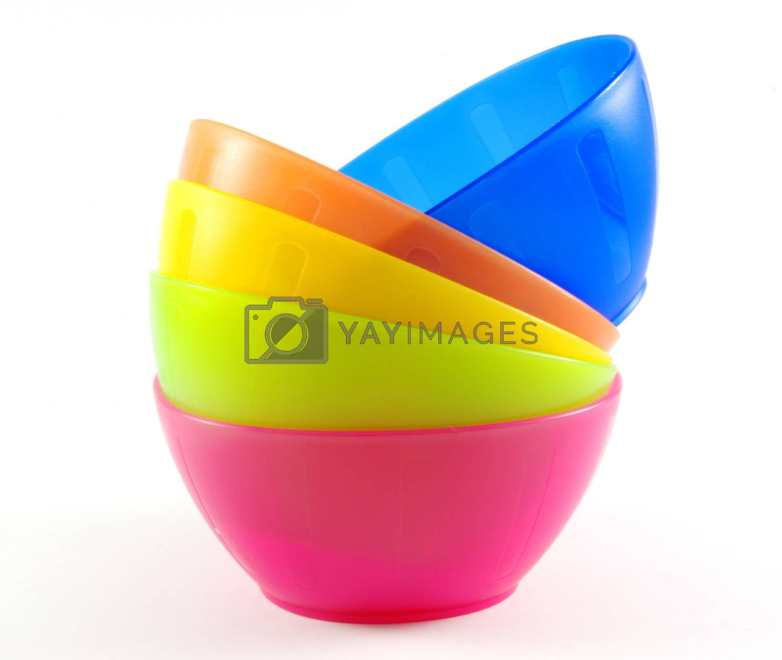 colorful plastic bowls isolated on white background