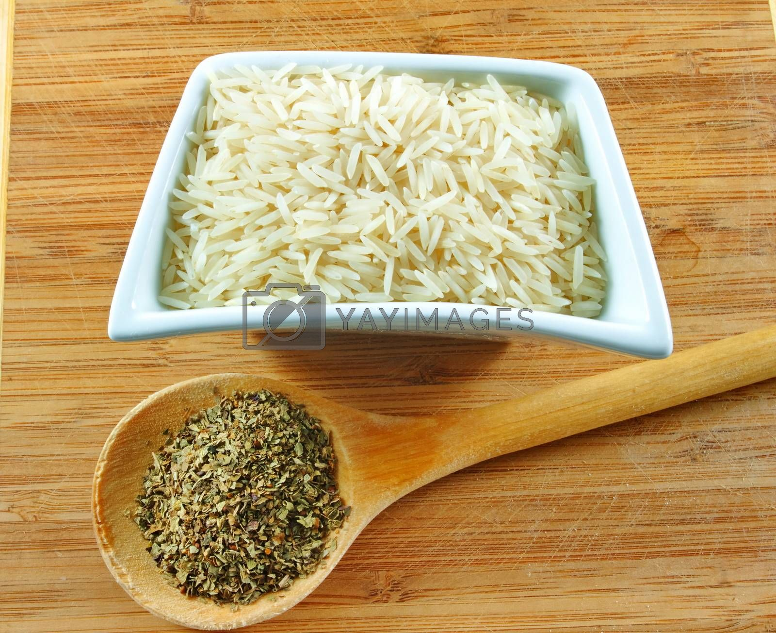 rice and herbs on the wooden board
