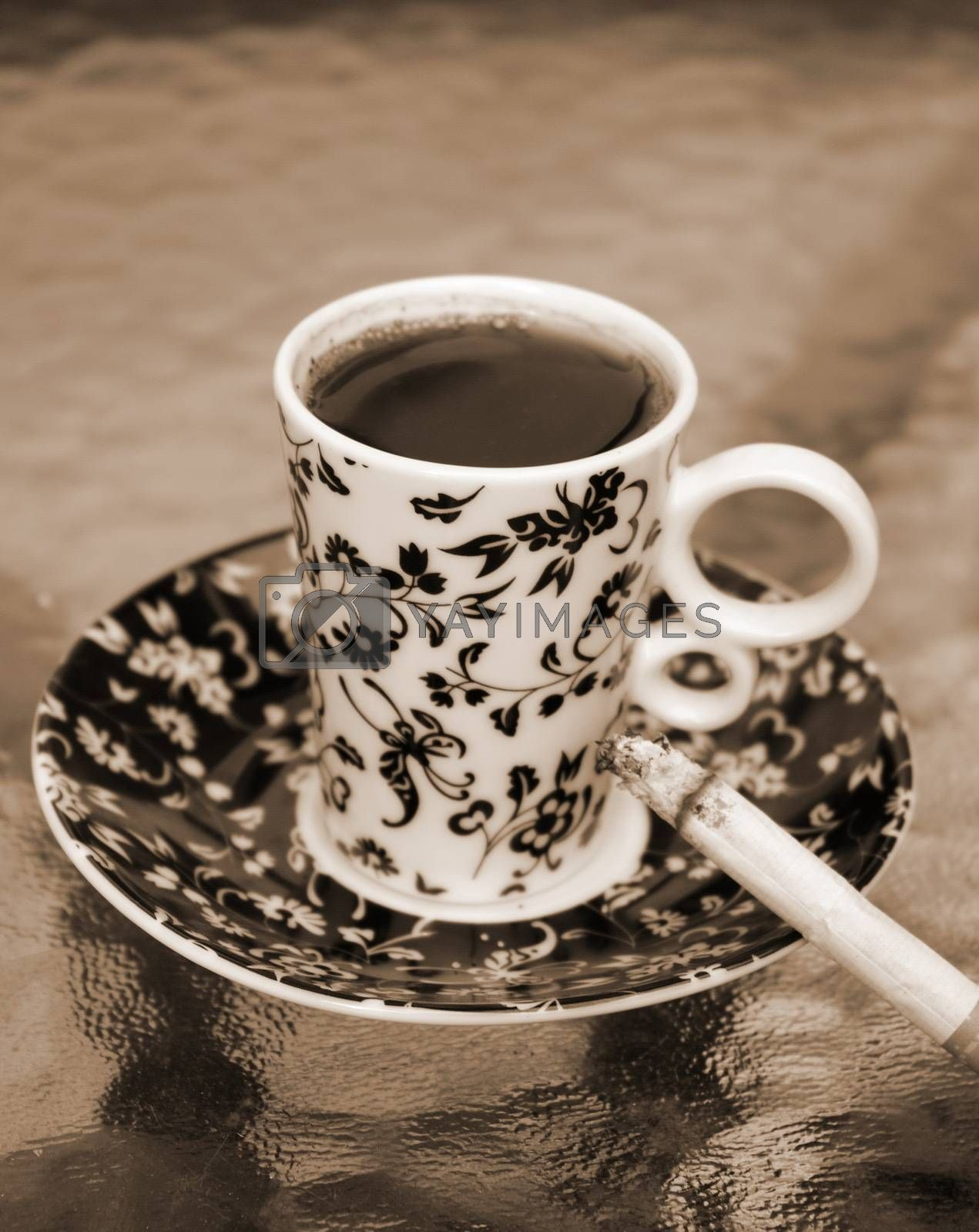 Cup of coffee with the cigarette
