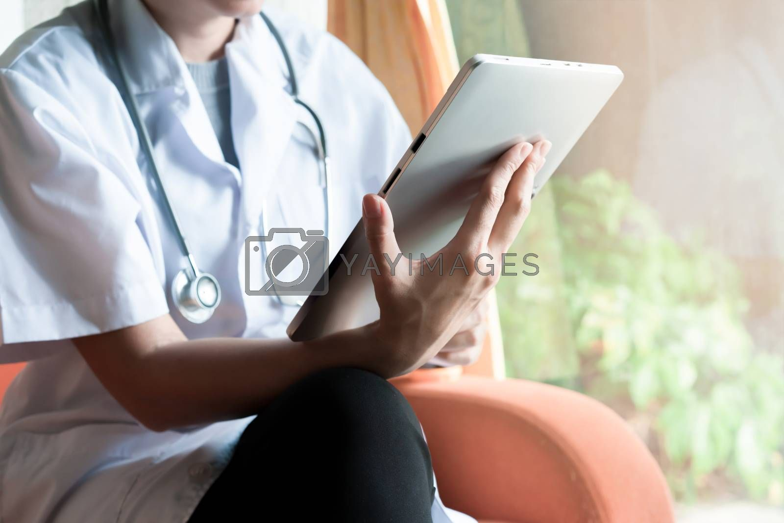 Royalty free image of Doctor online consultation with sick people on tablet and talk o by Buttus_casso