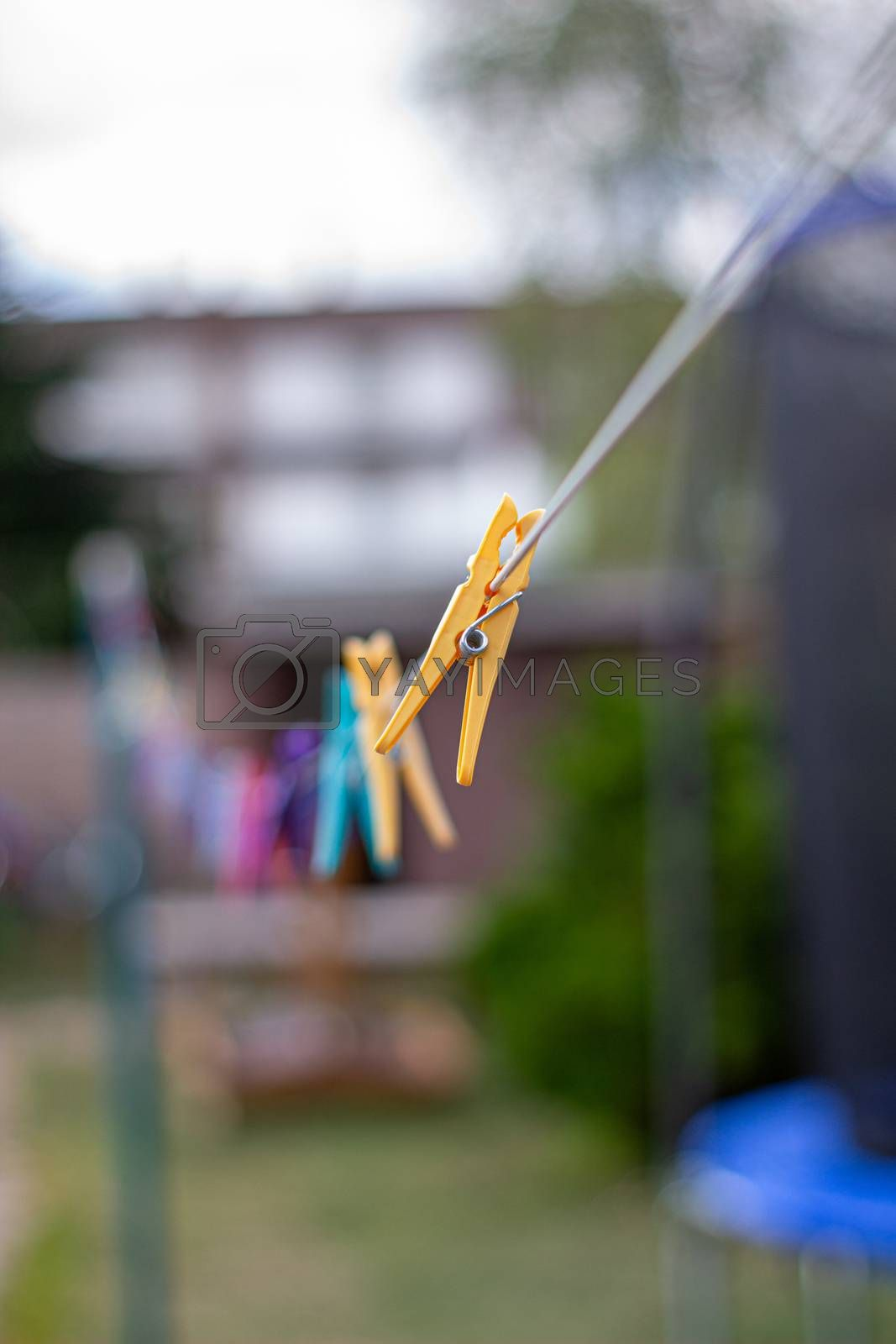 Colorful plastic clothespins on the hangers, clothespins on the hangers rope for wash clothes.