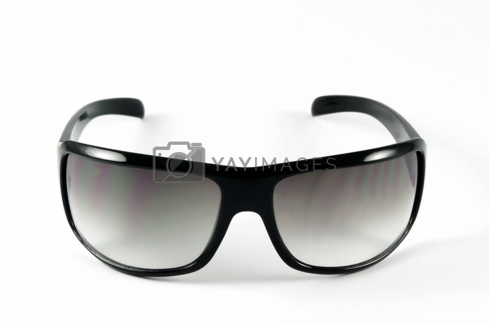 Modern sunglasses on white surface