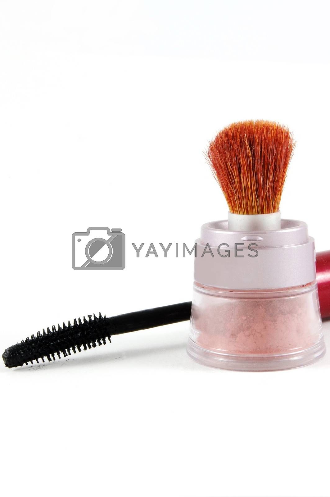 Make up and mascara brush over the white surface