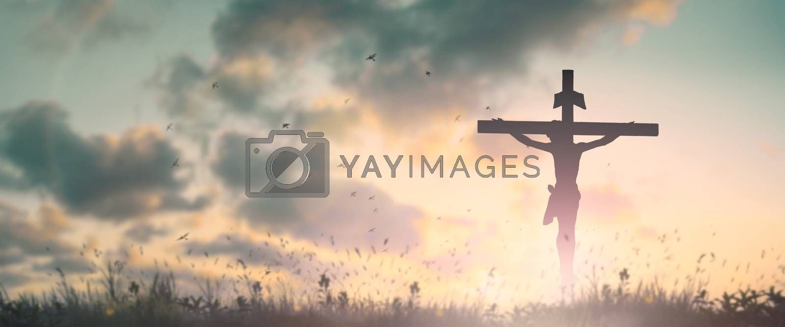 Silhouette jesus christ crucifix on cross on calvary sunset background concept for good friday he is risen in easter day, good friday jesus death on crucifix, world christian and holy spirit religious.