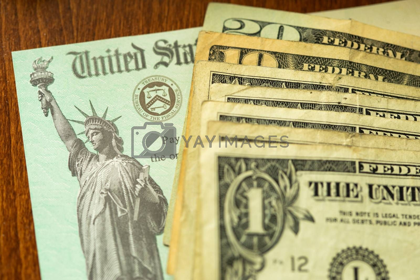 United States Internal Revenue Service, IRS, Check and Cash On Desk.
