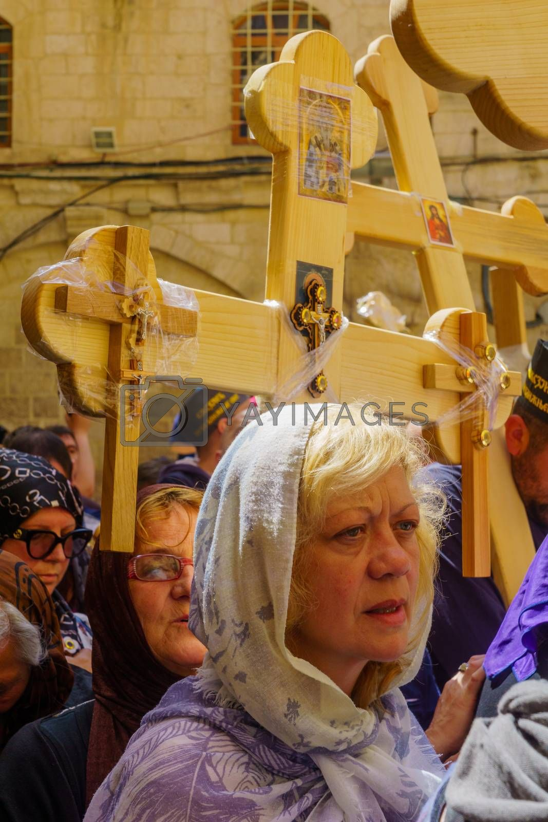 Jerusalem, Israel - April 6, 2018: Orthodox good Friday scene in the entry yard of the church of the holy sepulcher, with pilgrims. The old city of Jerusalem, Israel
