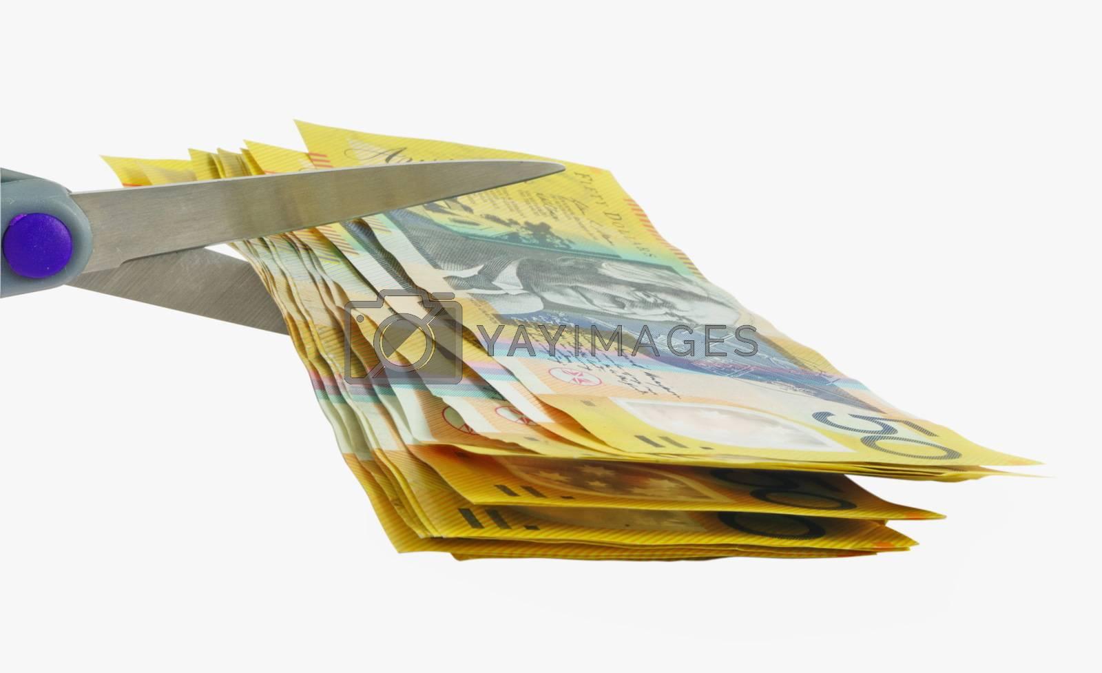 scissors cutting money over white background
