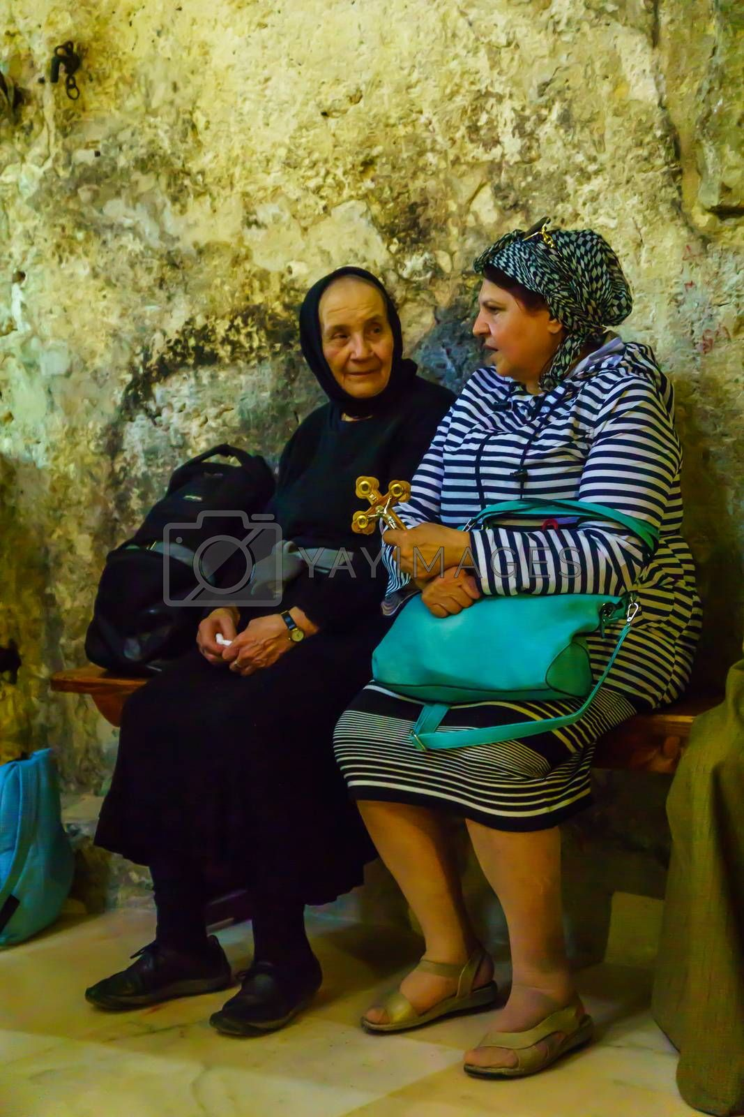 Jerusalem, Israel - April 6, 2018: Orthodox good Friday scene in the church of the holy sepulcher, with pilgrims. The old city of Jerusalem, Israel