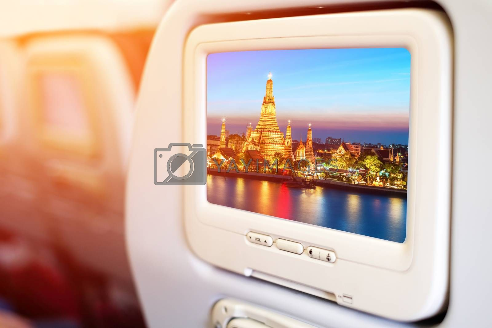 Aircraft monitor in passenger seat on Wat Arun night view Temple by Surasak