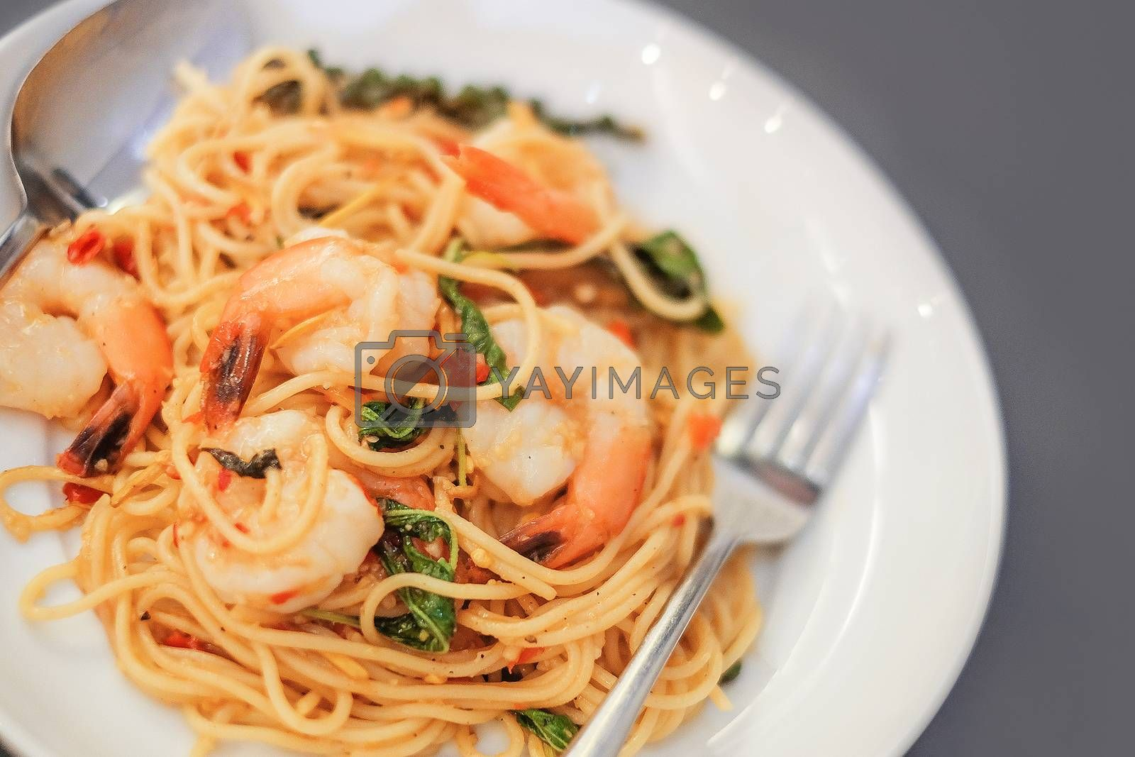 Spaghetti with seafood on gray background