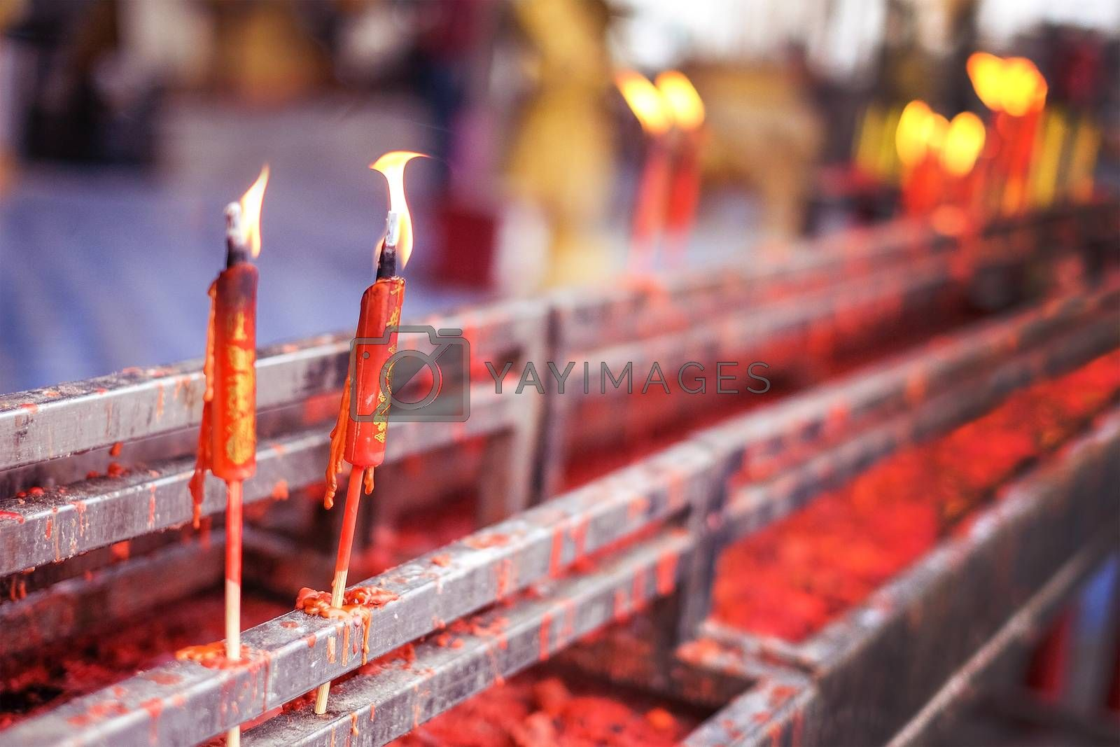 Burning red chinese candle in temple at Thailand