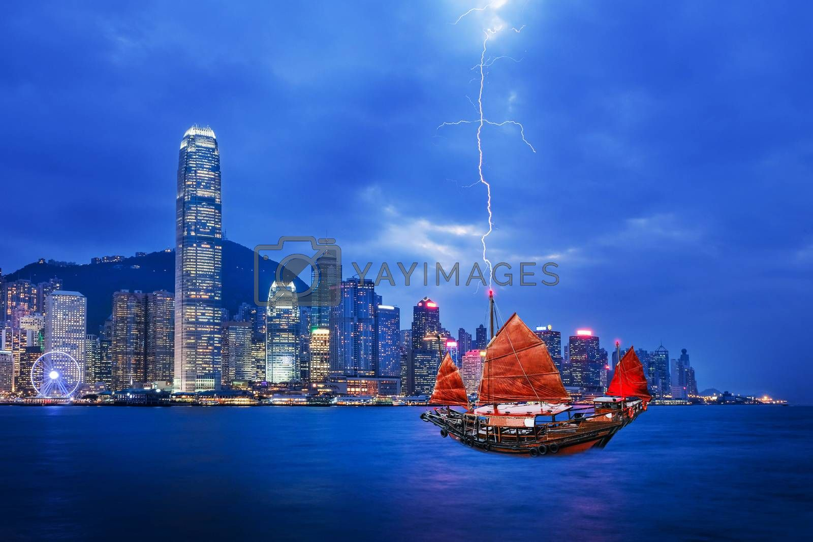 Red sailboat flag and thunderstorm in Hong Kong harbor