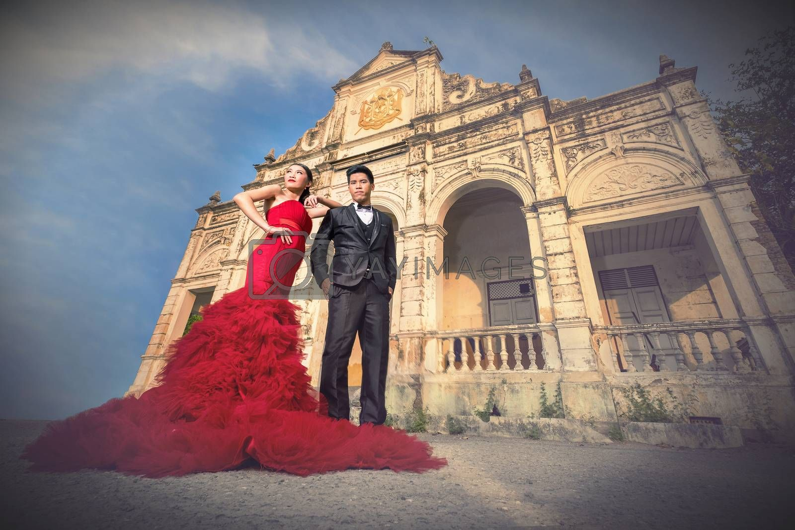 Man and Beautyful woman wearing fashionable red dress by Surasak