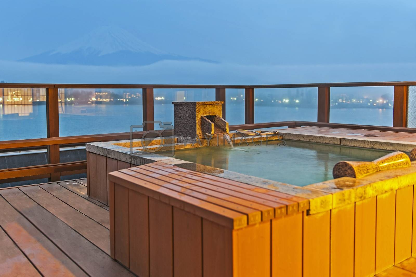 Japanese open air hot spa onsen with view of the mountain Fuji