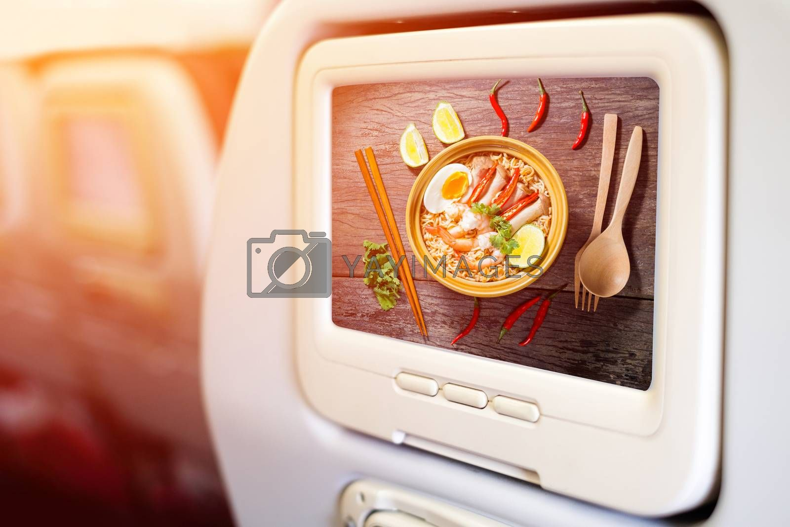 Aircraft monitor in front of passenger seat showing Thai food style noodle, Ma Ma tom yum kung