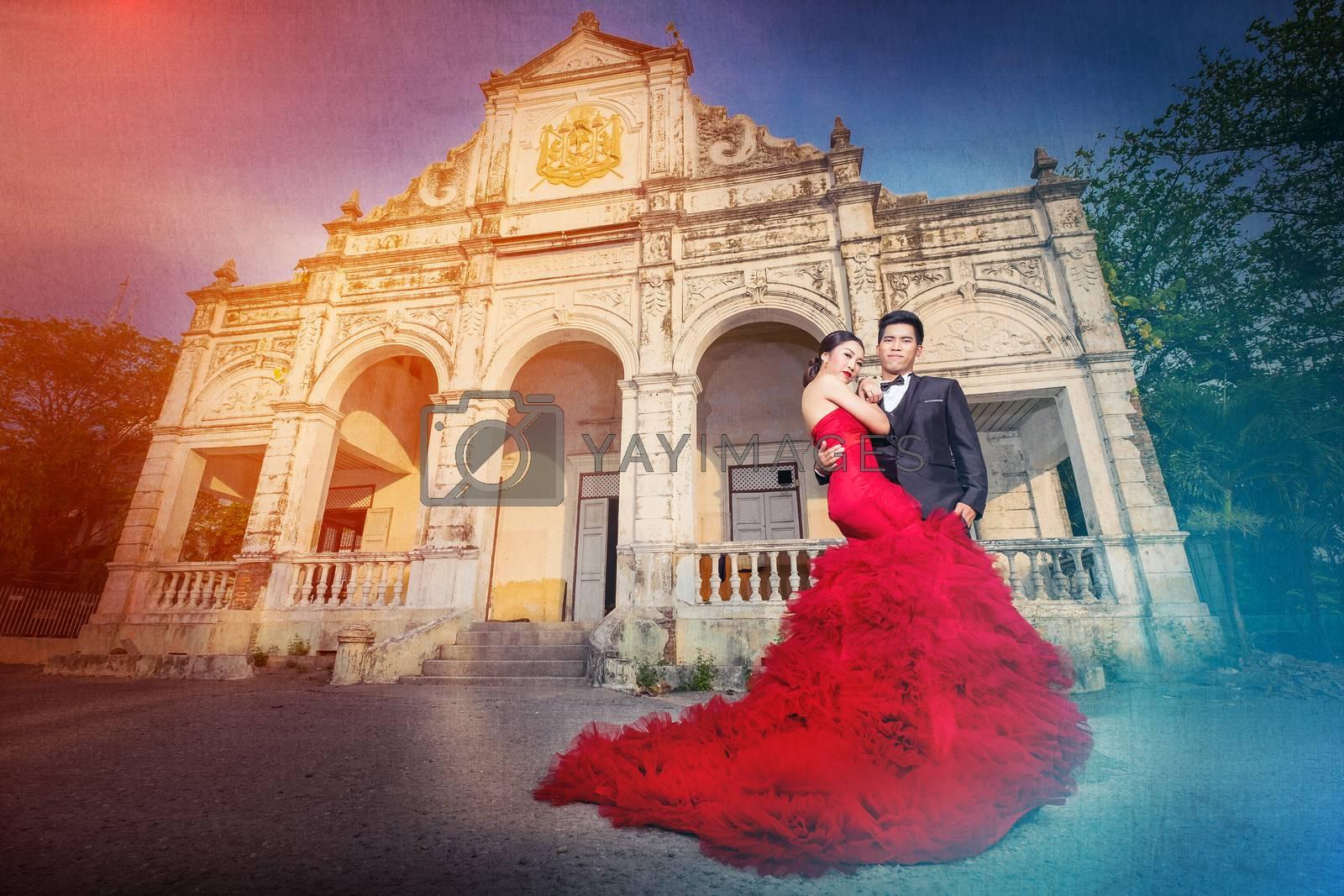 Man and Beautyful woman wearing fashionable red dress