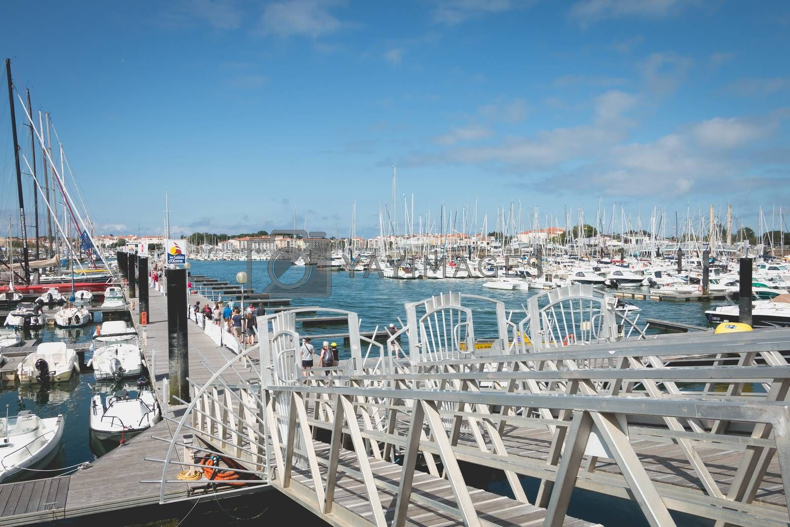 SABLES D OLONNE, FRANCE - July 24, 2016 : entrance to the marina where people are walking on the pontoons to watch the boats