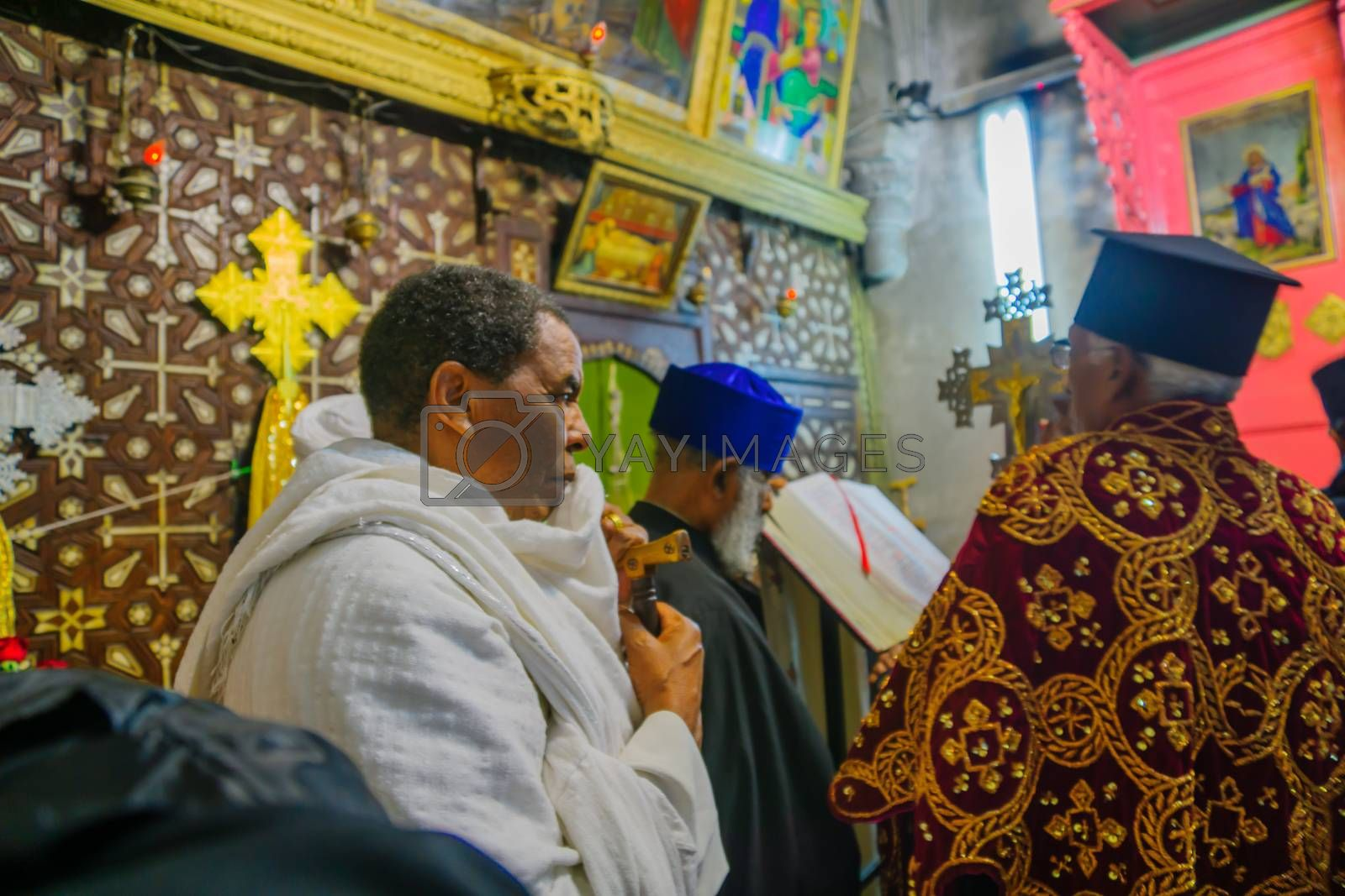 JERUSALEM, ISRAEL - APRIL 29, 2016: An Orthodox Good Friday pray of the Ethiopian community. The church of the Holy Sepulcher, the old city of Jerusalem, Israel