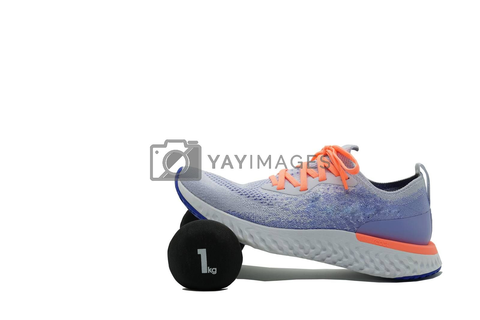 Sport shoe and dumbbell on isolated white background ,side,with copy space