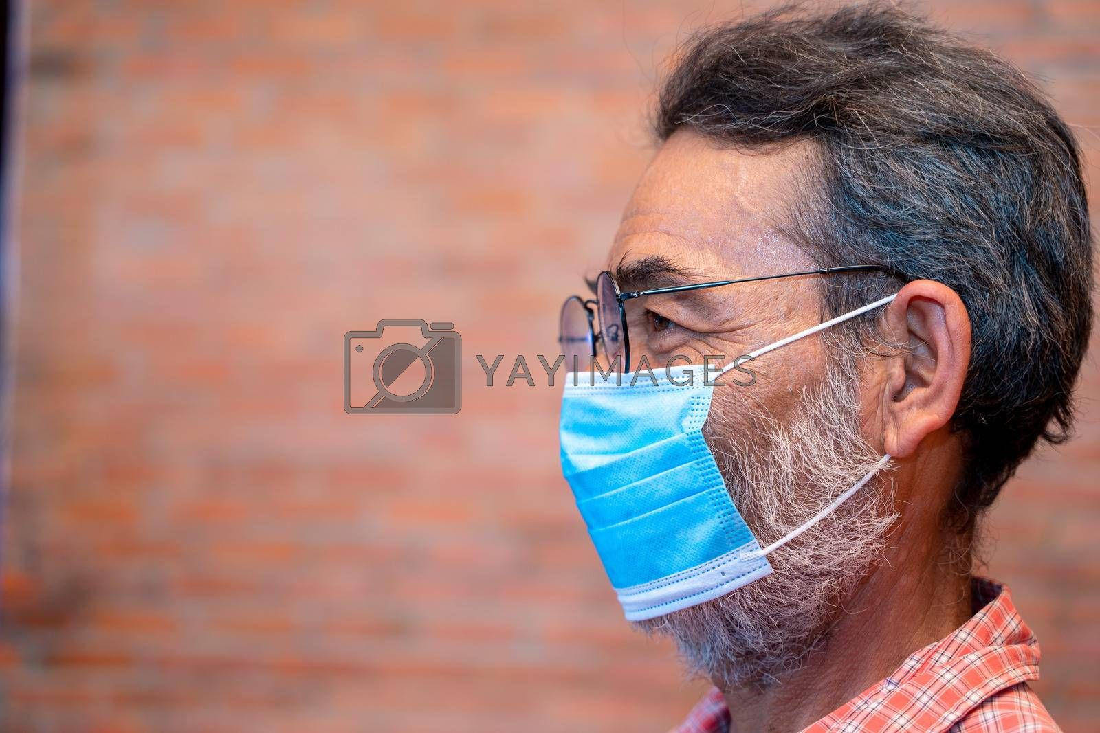 Elderly man wears protective mask against infectious diseases and flu,Concept of recommendations for protection against the virus.
