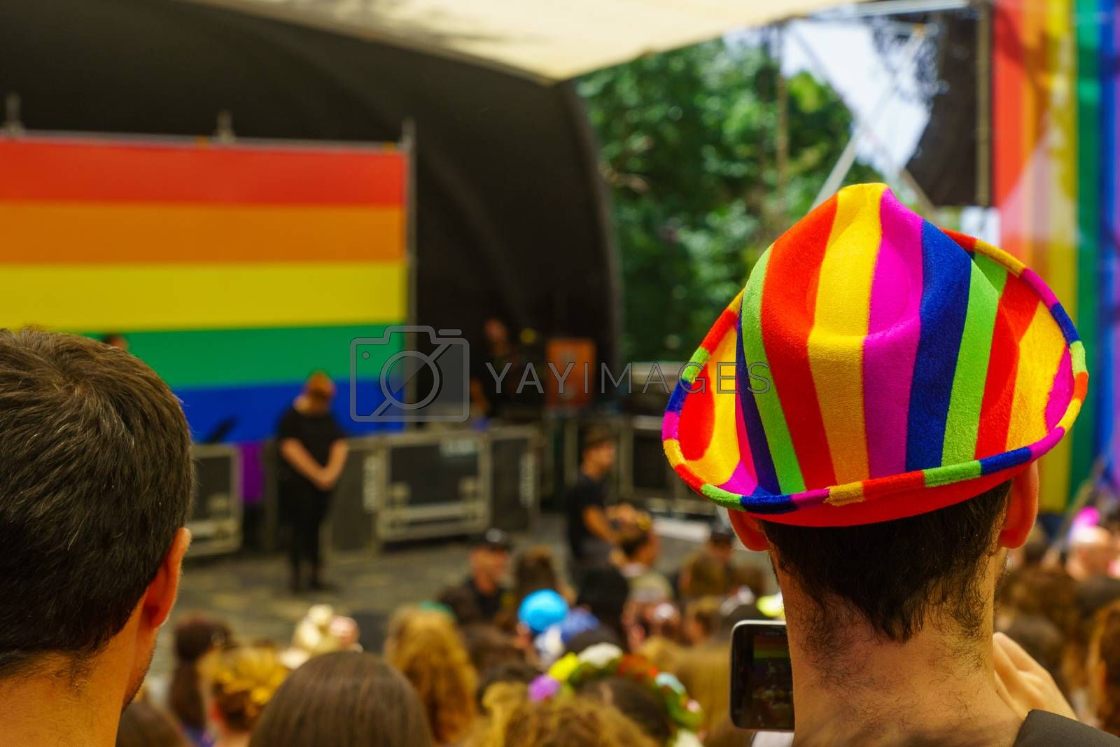 Haifa, Israel - June 28, 2019: Colorful hat and the crowd in the annual pride parade of the LGBT community, in the streets of Haifa, Israel