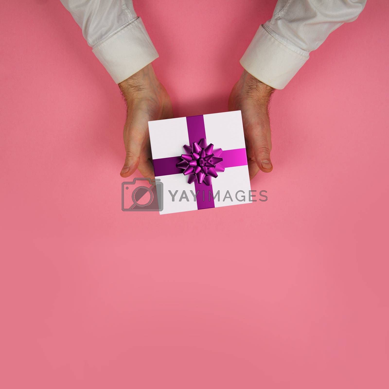 man offering a gift coloured background
