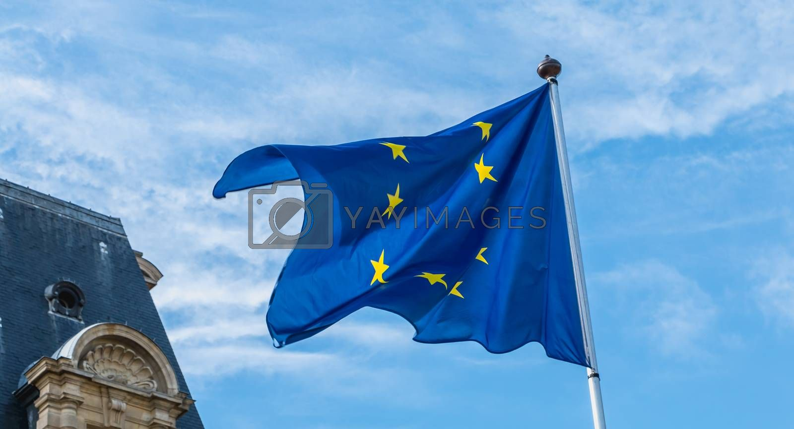 european flags flying in front of a town hall in France