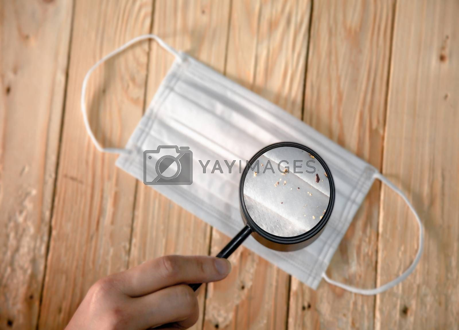 Magnifying glass to find the sanitary mask with virus and dust. hygienic mask to prevent the virus PM2.5 and Coronavirus. masks The outbreak of Novel Corona virus (2019-nCoV) or ( covid-19 )