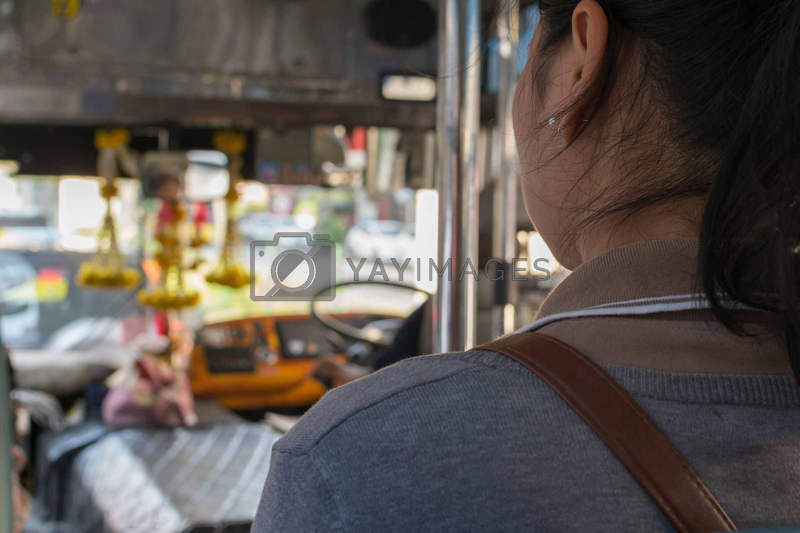 Bangkok, Thailand - March 15, 2016 : Unidentified people travel by bus in Bangkok. Buses are one of the most important public transport system in Bangkok.