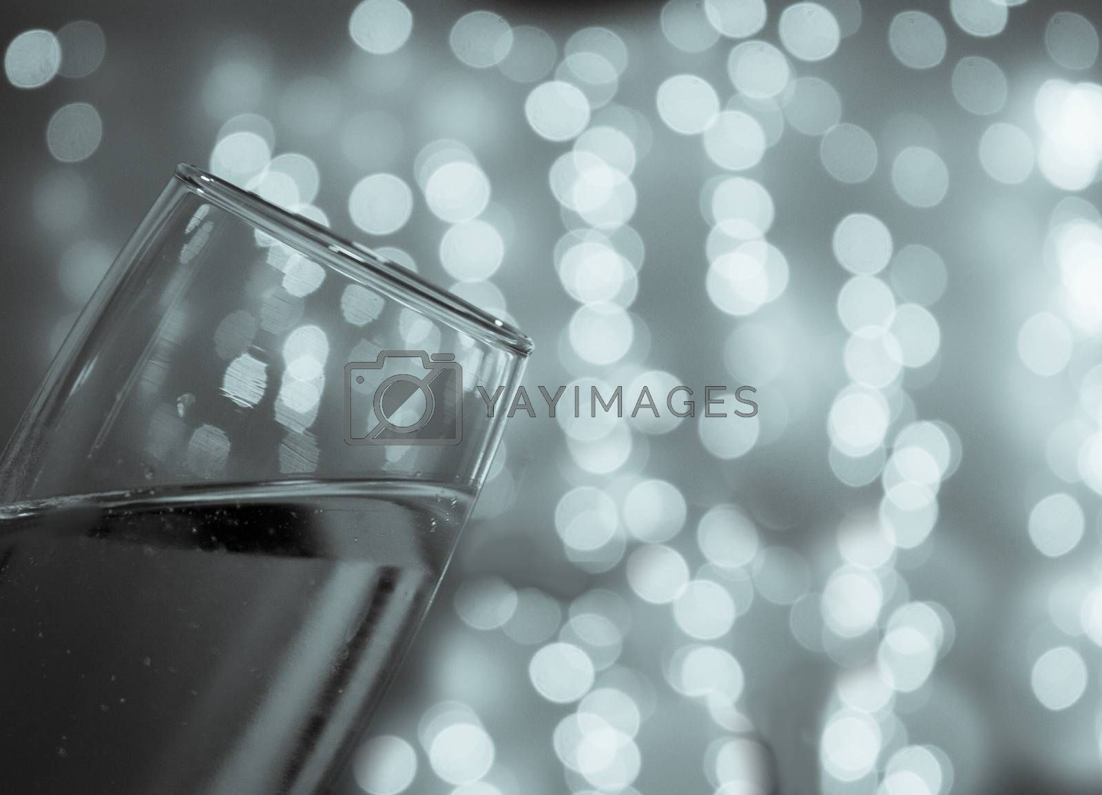 Toast with a champagne glass over defocused background