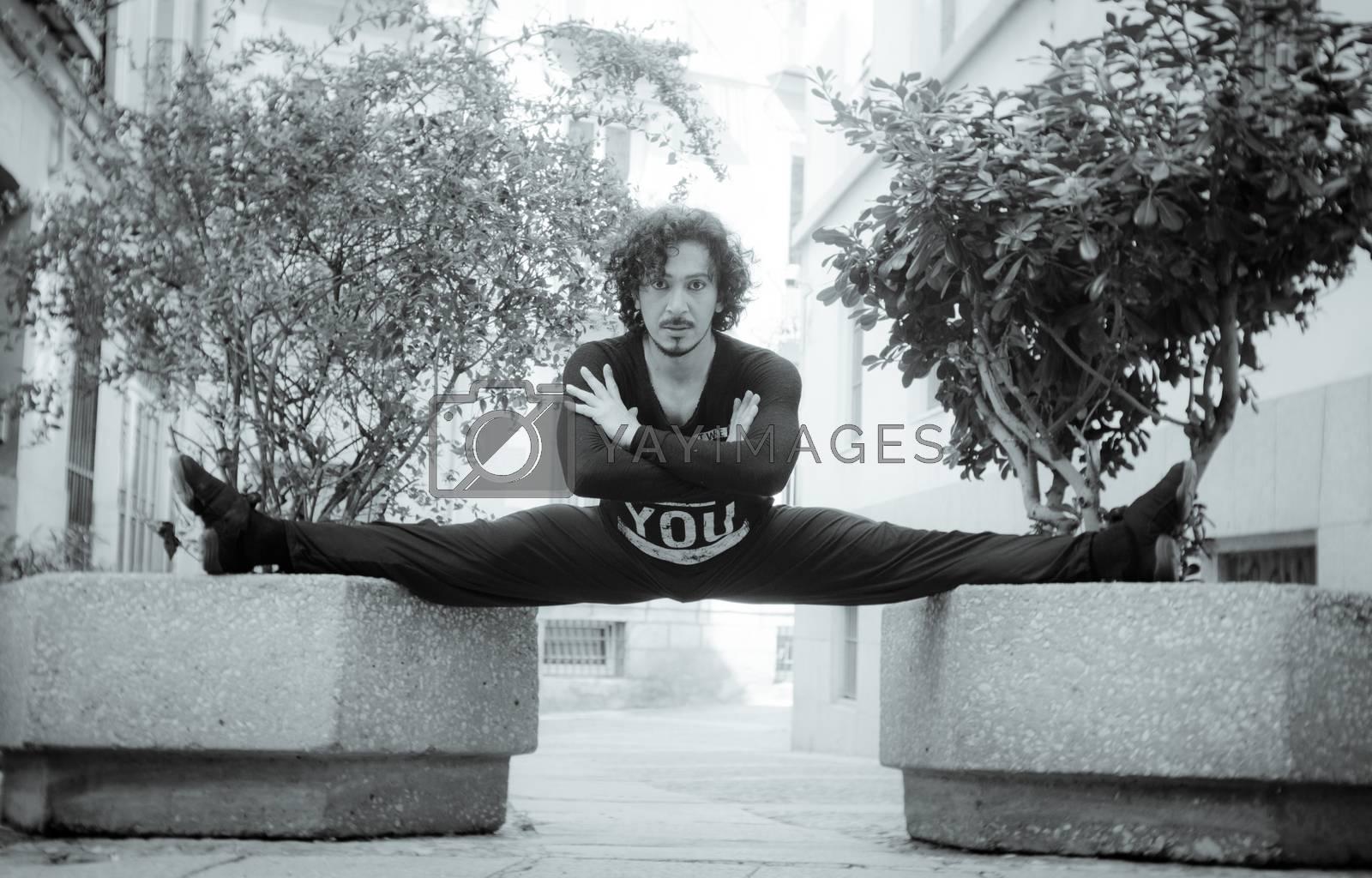 Male dancer in ballet pose by GemaIbarra