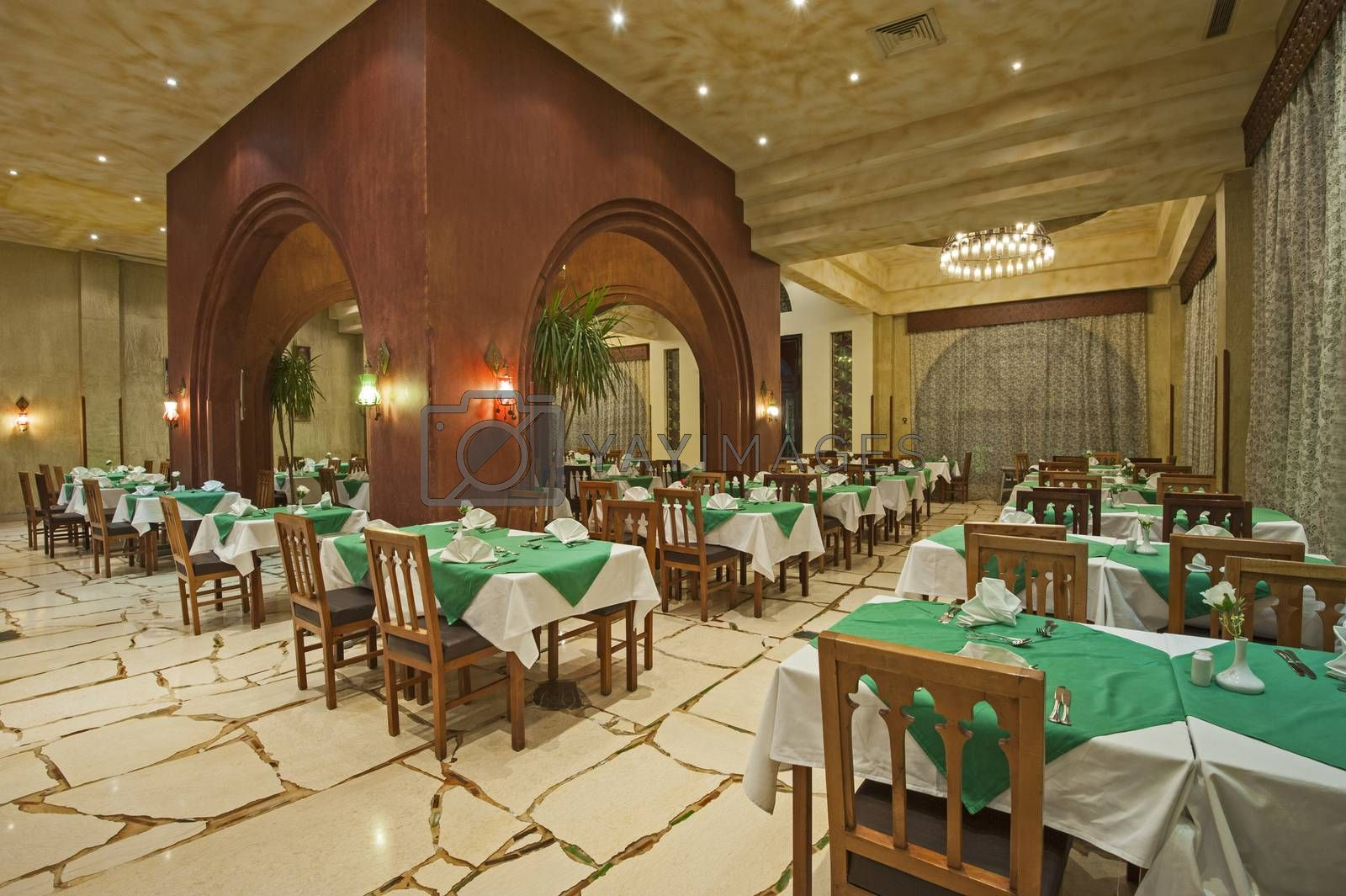 Interior design of a luxury hotel restaurant dining area with ornate decor