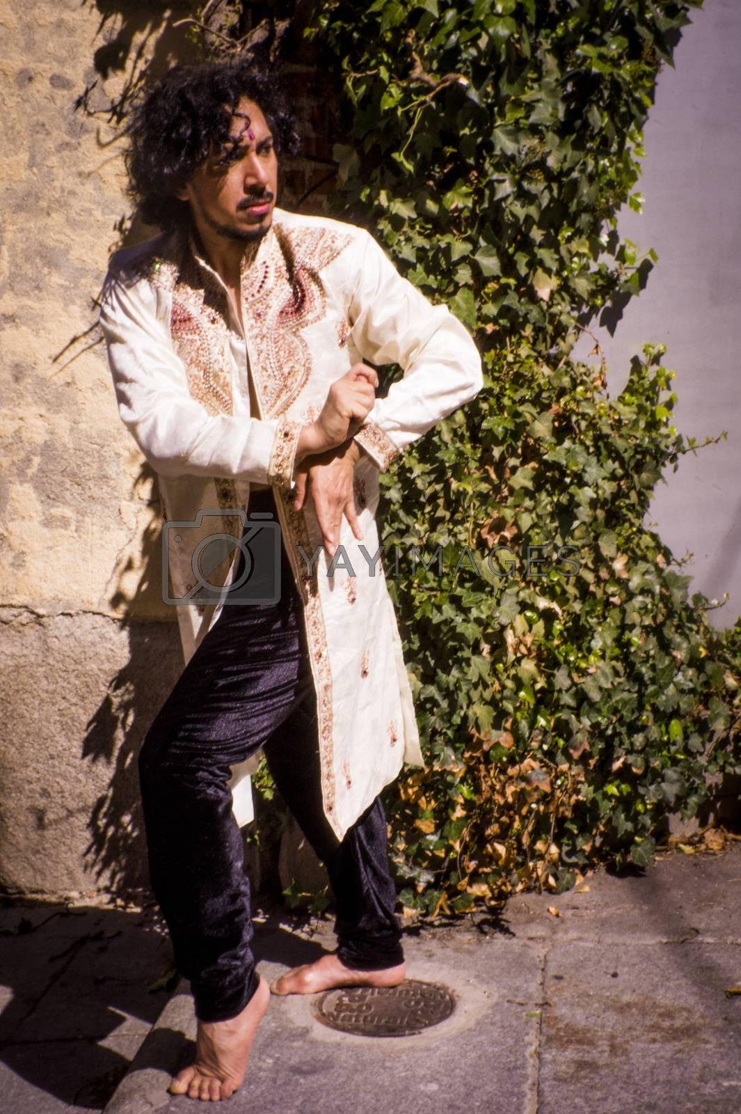 Bollywood dancer man over urban background