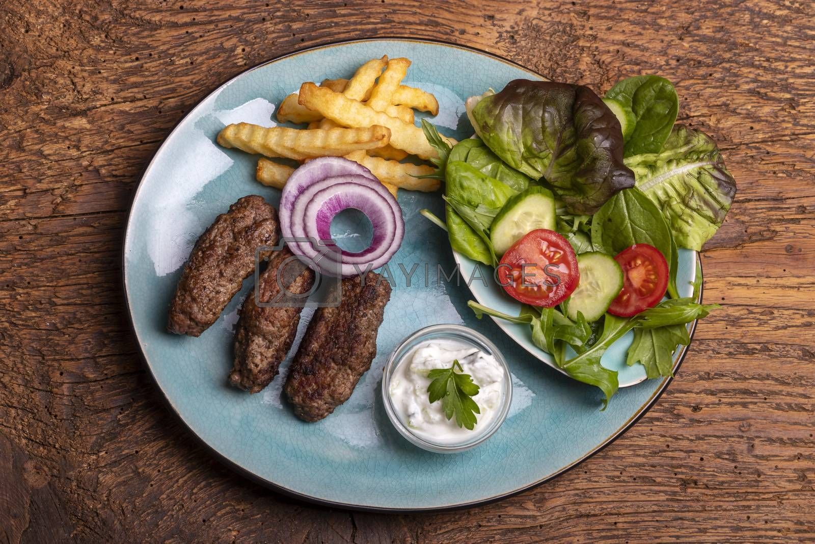 cevapcici with french fries and salad