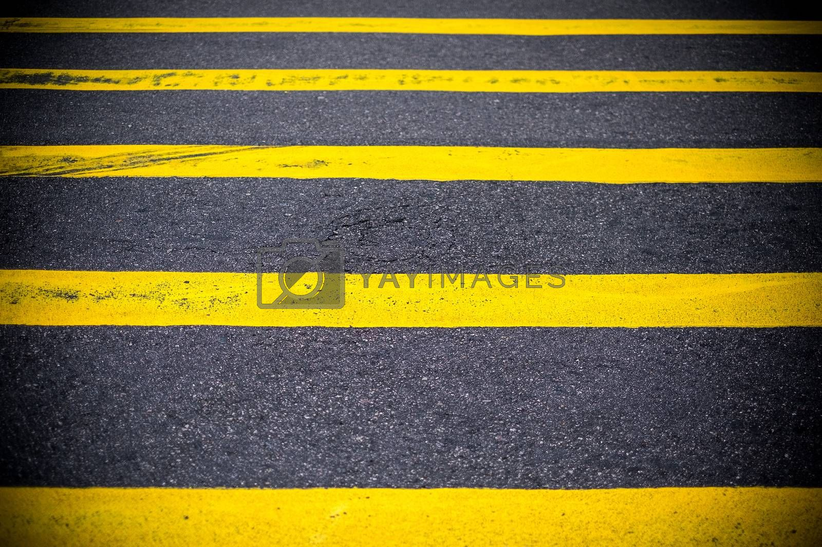 Road Marking Yellow Lines on asphalt
