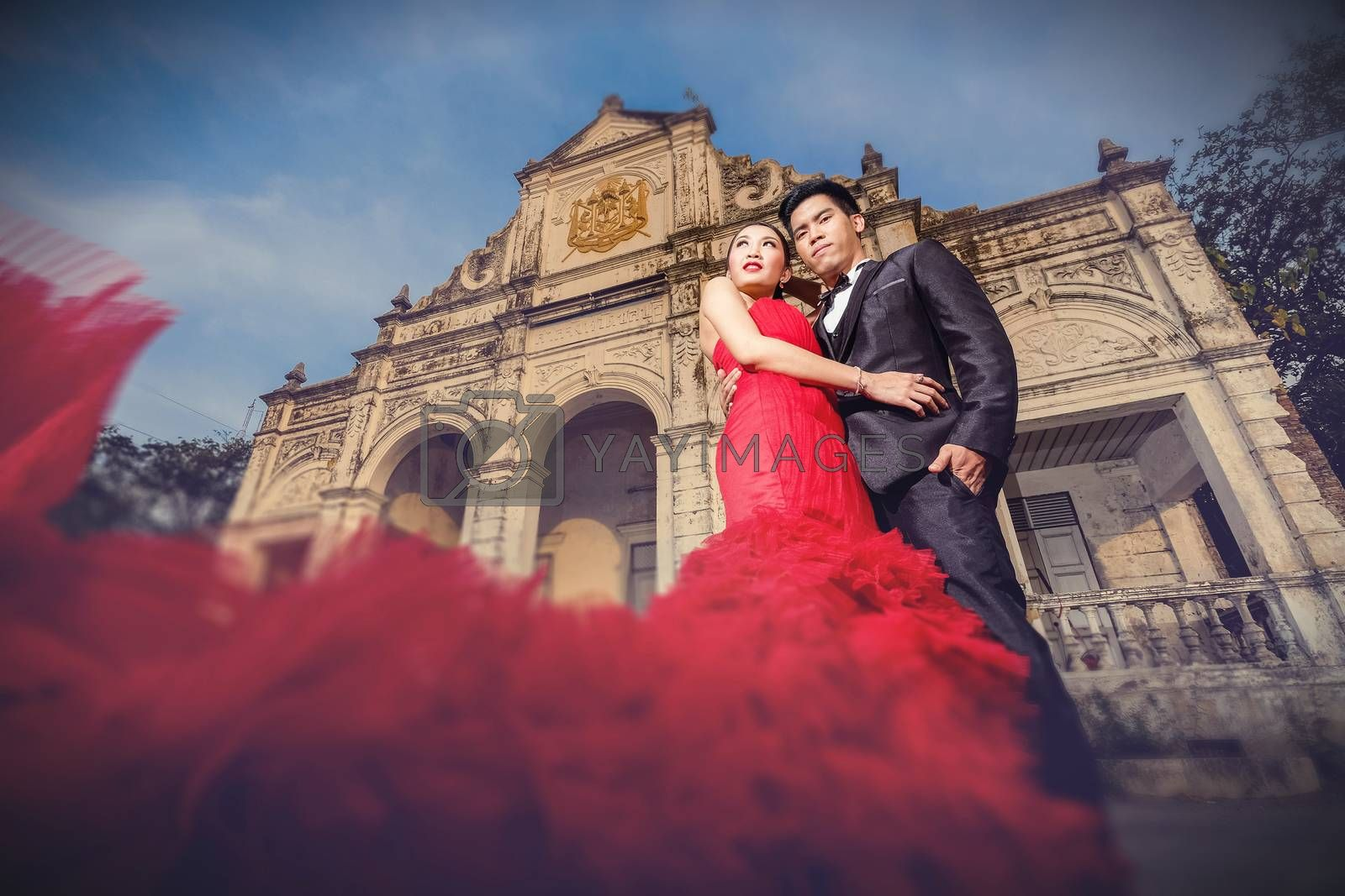 Man in black suit and Beautyful woman wearing fashionable red dress