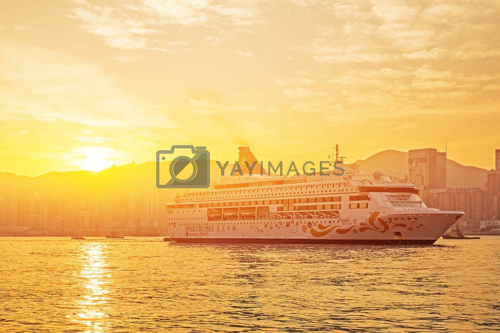 HONG KONG - JAN 13: Victoria Harbor on Jan 13, 2016 in Hong Kong. Big Cruise Ship departed from Ocean Terminal and drove across Victoria Harbor at sunrise.