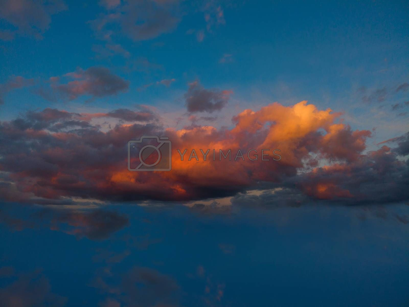 Dark cloudy sky background over the sunset in the evening summer sky