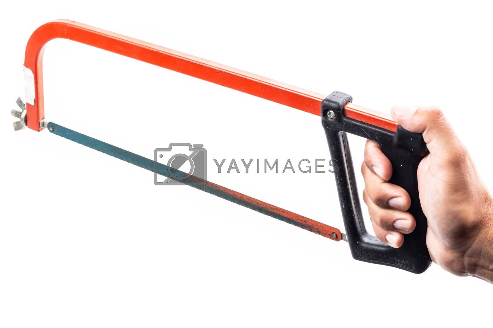 man who serves in his hand a rusty red hacksaw on a white background in studio