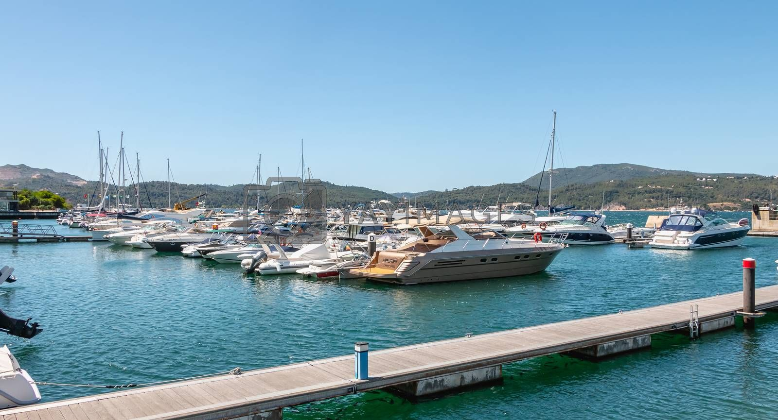 Troia, Portugal - August 9, 2018: View of the Troia Marina with its luxurious boats on a summer day