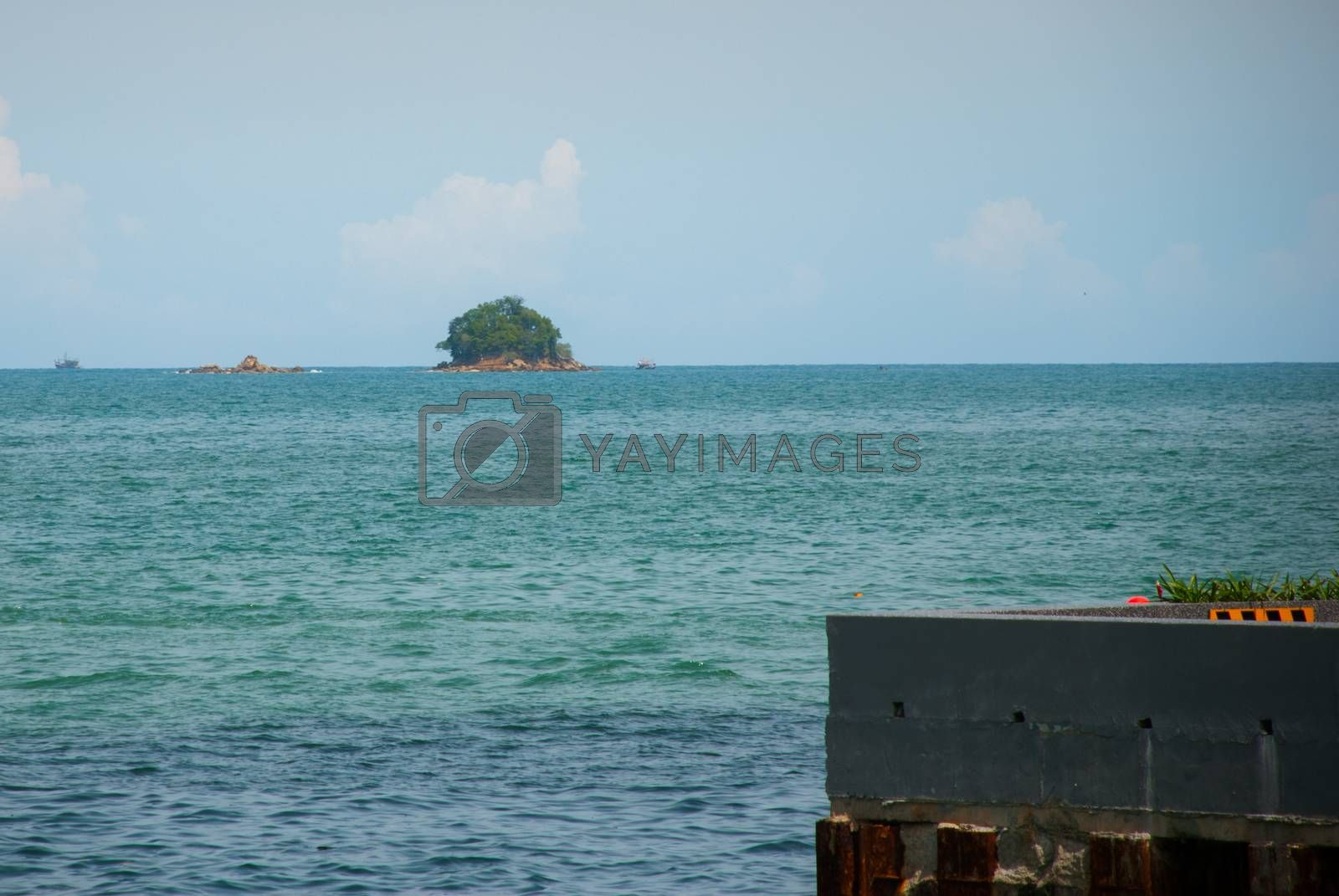 KOTA KINABALU, SABAH, MALAYSIA - MARCH 2017: The view of the island from the waterfront. Kota Kinabalu City is the capital of the state of Sabah, located in East Malaysia.