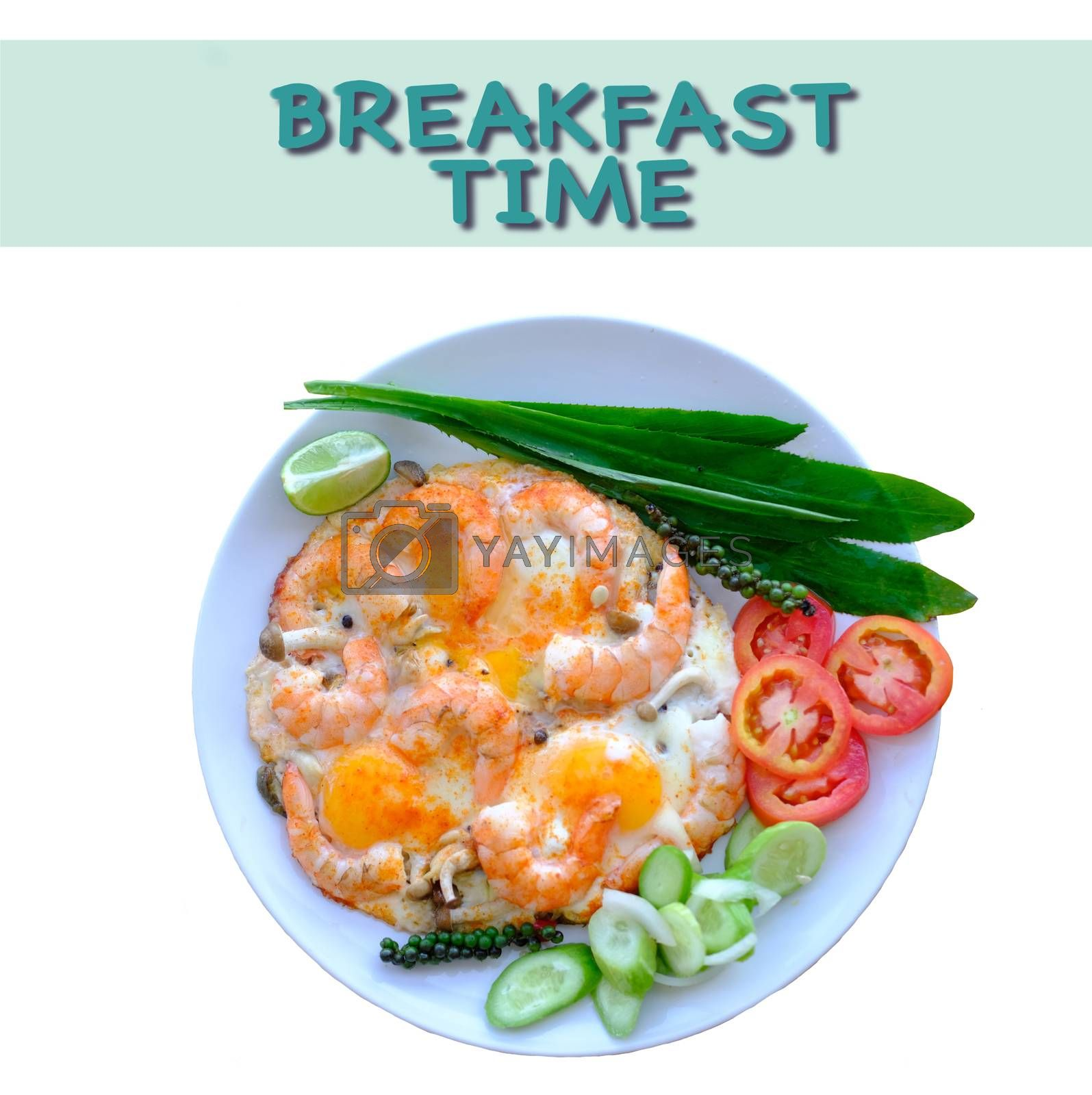 Fried eggs and shimps decorate with fresh vegetables top view isolated with inscription breakfast time.