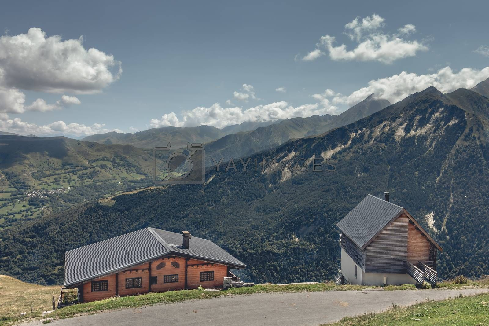 Saint Lary, France - August 20, 2018: Typical mountain log cabins on the height of the mountains with a plummeting view of the valley