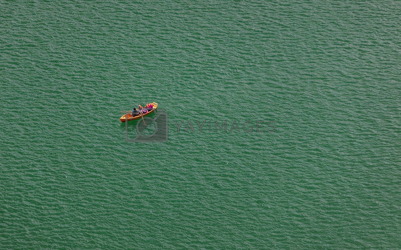 Lake Bled, Slovenia. Top view of a boat sailing in the lake. Bled lake is the most famous lake in Slovenia. Bled, Slovenia.